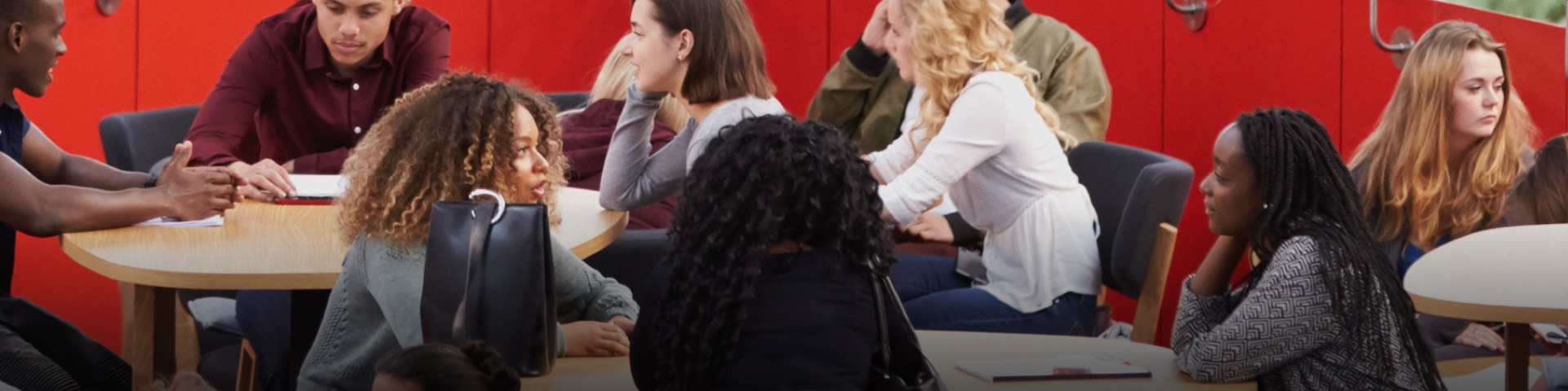 Picture of female students in discussion at Solent