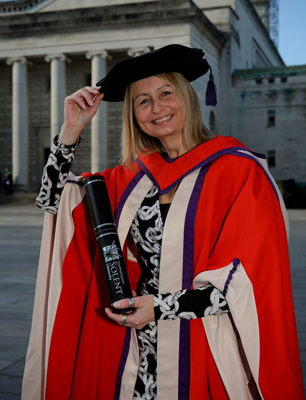 Francesca Berriman MBE with her honorary doctorate outside the Guildhall, Southampton
