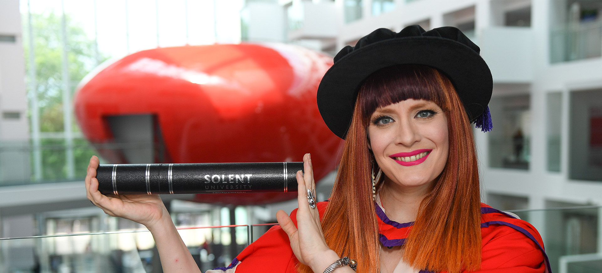 Ana Matronic holding her certificate