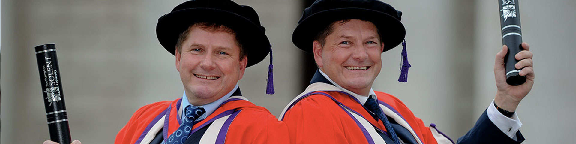 Pete and Pip Tyler with their honorary degrees from Solent University