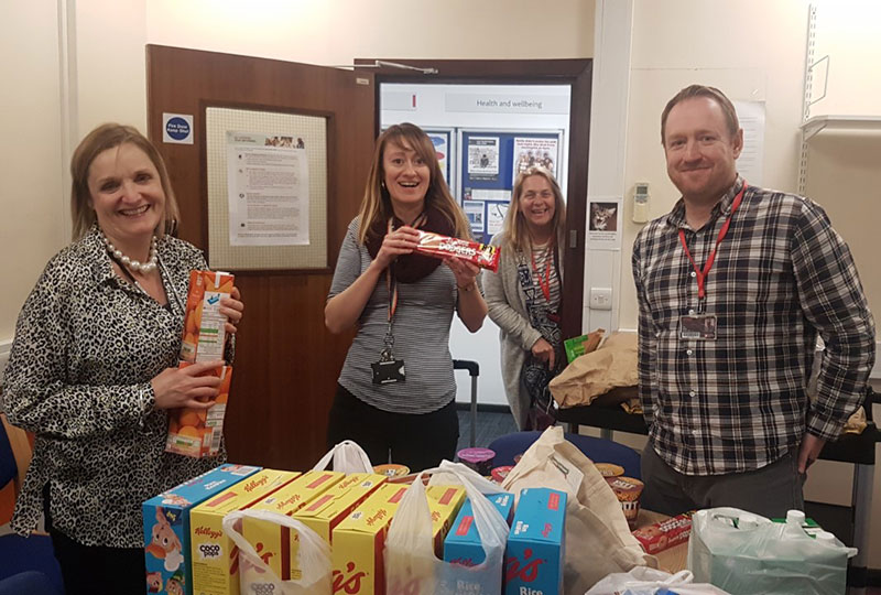 Solent's student services team with food supplies for students