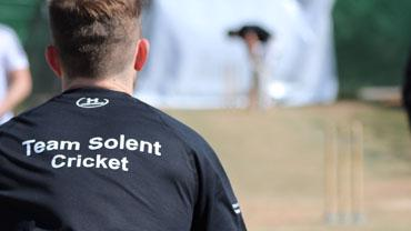 Team Solent cricket player about to bowl