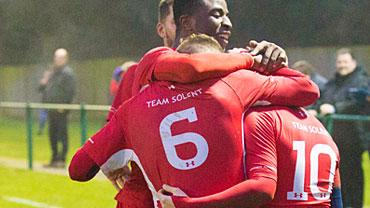 Team solent men's team hugging