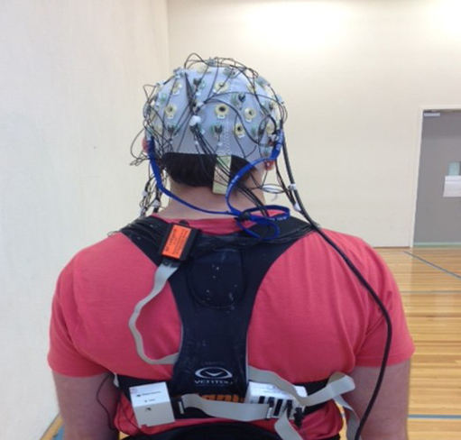 View of the back of a person wired up for EEG testing