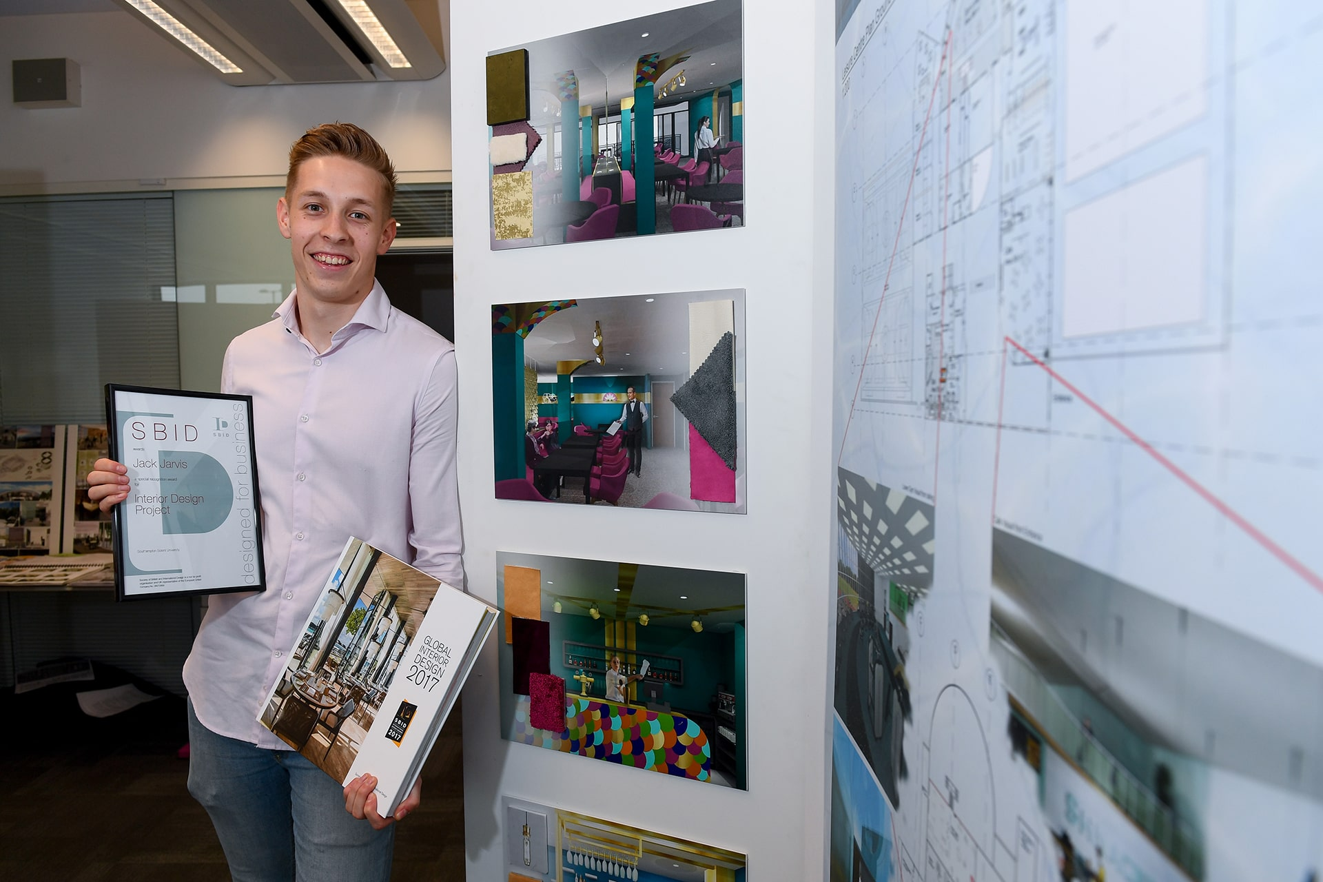 BA (Hons) Interior Design alumnus with his award from the SBID