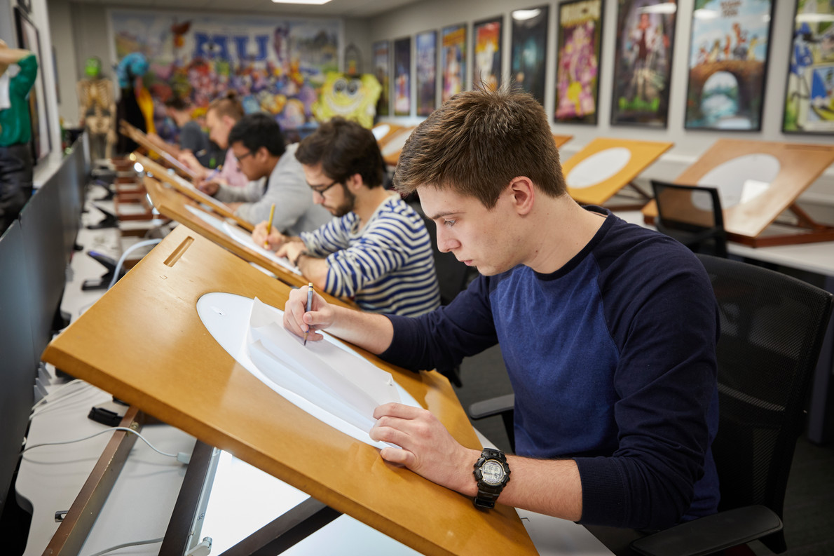 Animation students using a light-box