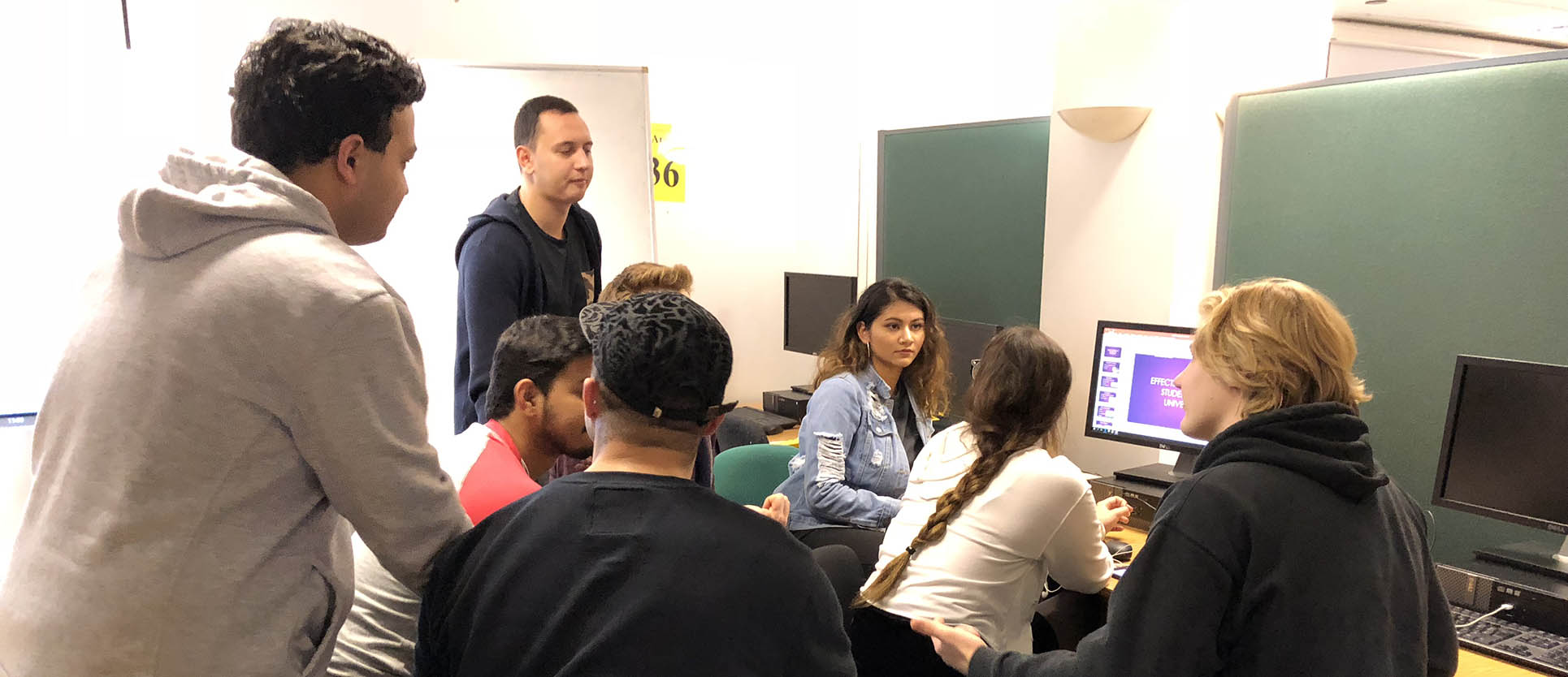 students in a classroom talking