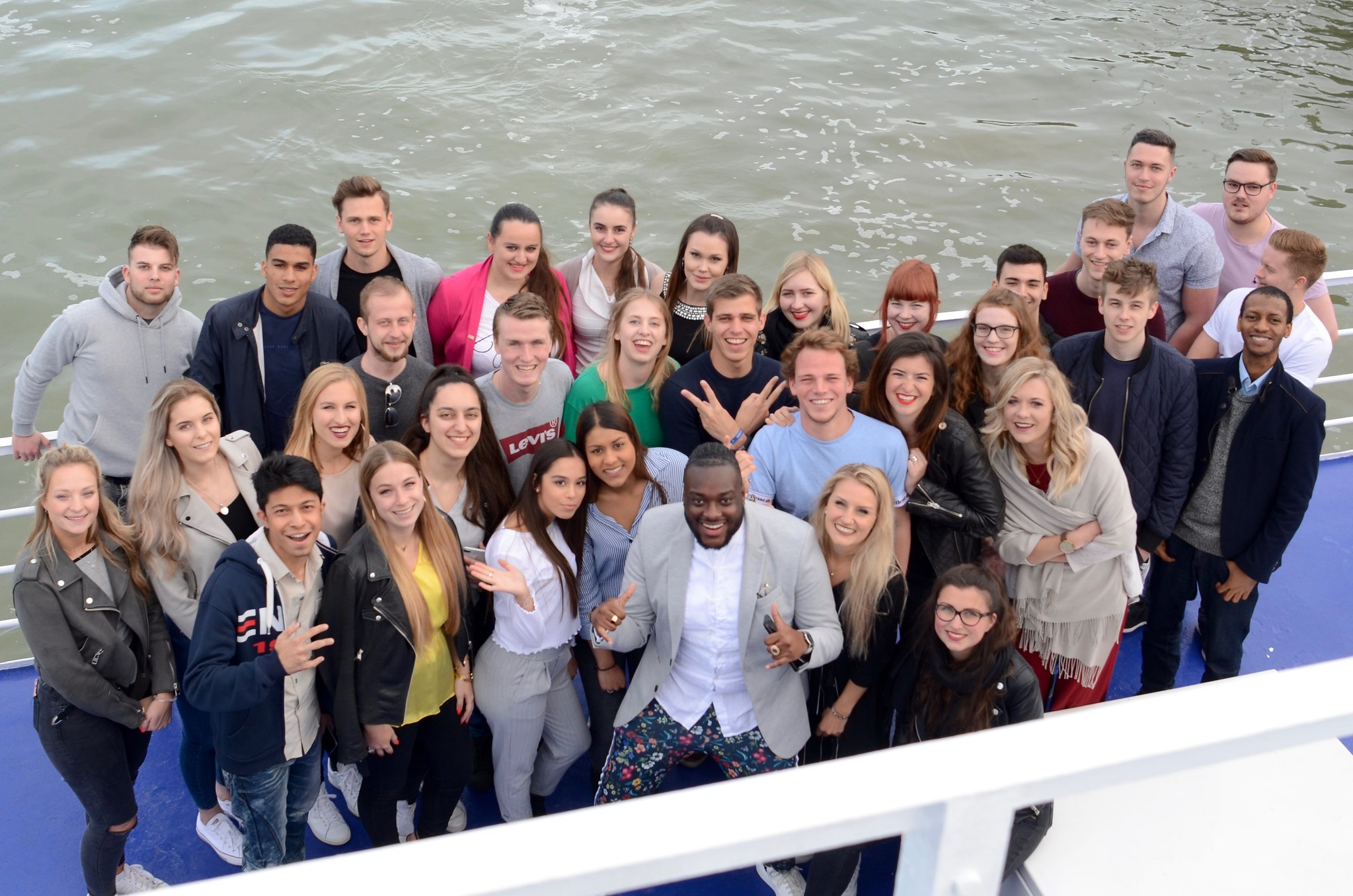 Students on a boat as part of international business and marketing week