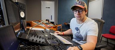 A Foundation Year in Popular Music student at a mixing desk